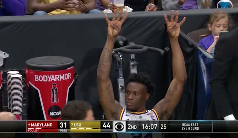 LSU's Emmitt Williams honors fallen teammate Wayde Sims by holding up his jersey number 44.