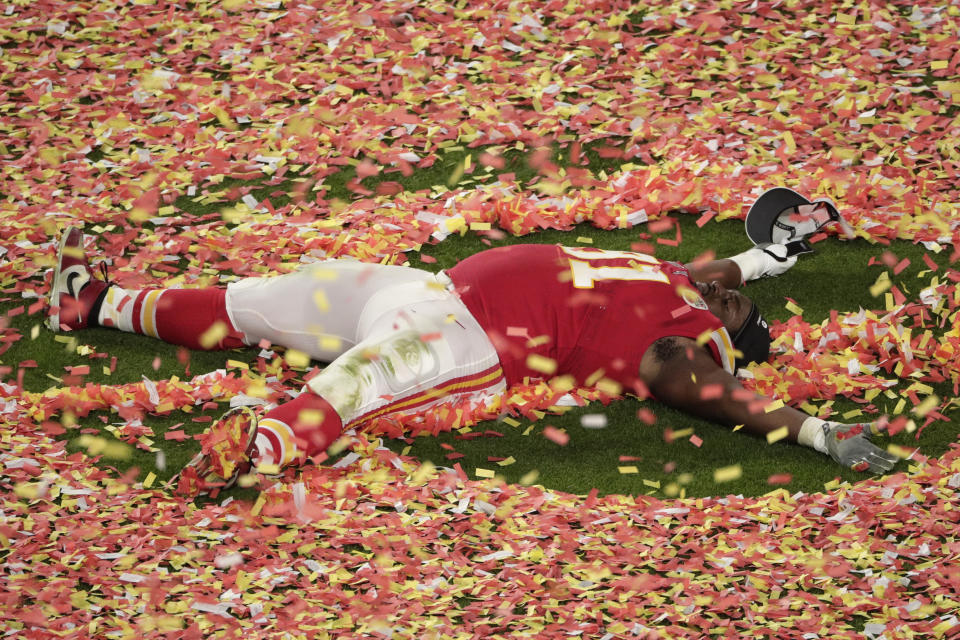 Kansas City Chiefs' Derrick Nnadi (91) plays with the confetti, at the end of the NFL Super Bowl 54 football game against the San Francisco 49ers, Sunday, Feb. 2, 2020, in Miami Gardens, Fla. The Chiefs' defeated the 49ers 31-20. (AP Photo/Charlie Riedel)