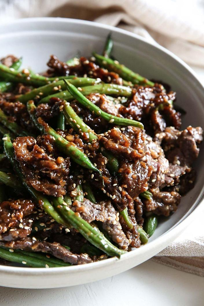 """<p>This is the most flavorful a stir-fry could ever be.</p><p>Get the recipe from <a href=""""https://www.delish.com/cooking/recipe-ideas/recipes/a51791/sesame-ginger-beef-recipe/"""" rel=""""nofollow noopener"""" target=""""_blank"""" data-ylk=""""slk:Delish"""" class=""""link rapid-noclick-resp"""">Delish</a>.</p>"""