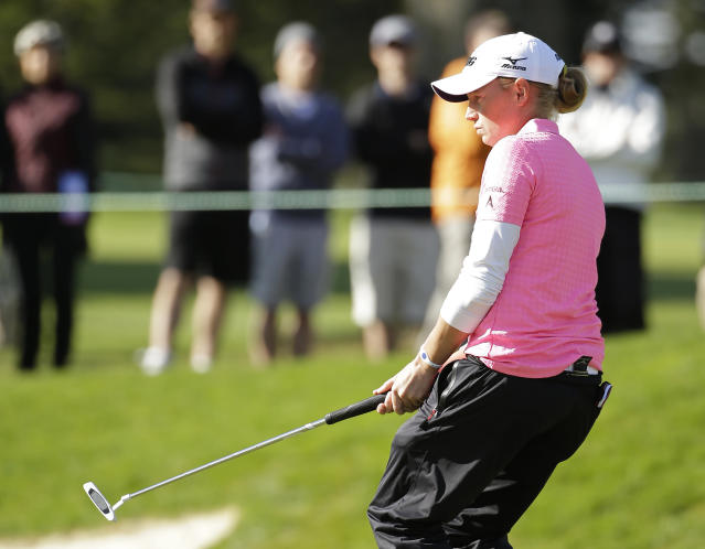 Stacy Lewis reacts after missing a birdie putt on the 14th green of the Lake Merced Golf Club during the third round of the Swinging Skirts LPGA Classic golf tournament on Saturday, April 26, 2014, in Daly City, Calif. (AP Photo/Eric Risberg)