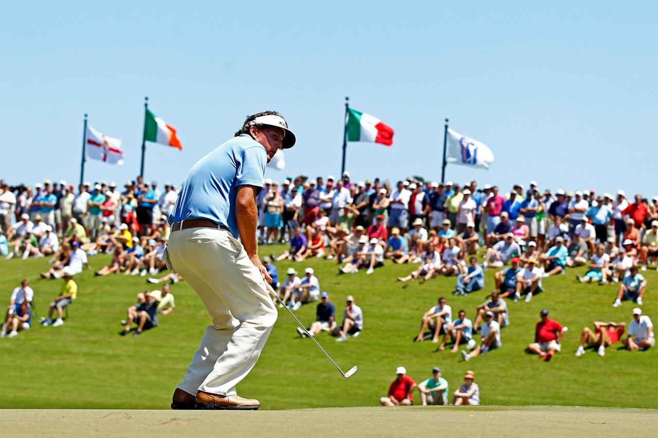 PONTE VEDRA BEACH, FL - MAY 10:  Phil Mickelson of the United States reacts to a missed putt for birdie on the third hole during the first round of THE PLAYERS Championship held at THE PLAYERS Stadium course at TPC Sawgrass on May 10, 2012 in Ponte Vedra Beach, Florida.  (Photo by Mike Ehrmann/Getty Images)