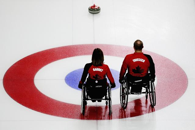 SOCHI, RUSSIA - MARCH 08: Sonja Gaudet and Dennis Thiessen of Canada compete during the wheelchair curling mixed round robin match between Canada and Great Britain at the Ice Cube Curling Center on March 8, 2014 in Sochi, Russia. (Photo by Hannah Peters/Getty Images)