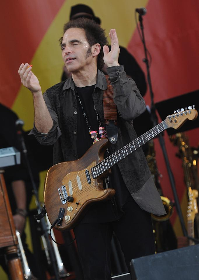 NEW ORLEANS, LA - APRIL 29:  Nils Lofgren of Bruce Springsteen and the E Street Band performs during the 2012 New Orleans Jazz & Heritage Festival Day 3 at the Fair Grounds Race Course on April 29, 2012 in New Orleans, Louisiana.  (Photo by Rick Diamond/Getty Images)