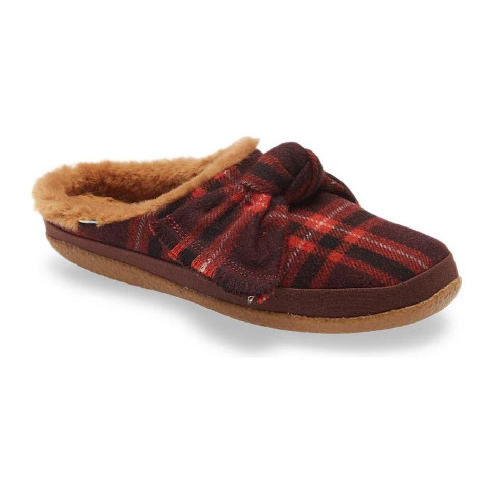 """<p><strong>TOMS</strong></p><p>nordstrom.com</p><p><strong>$35.72</strong></p><p><a href=""""https://go.redirectingat.com?id=74968X1596630&url=https%3A%2F%2Fwww.nordstrom.com%2Fs%2Ftoms-ivy-slipper-women%2F5773866&sref=https%3A%2F%2Fwww.prevention.com%2Flife%2Fg34751763%2Fgifts-that-give-back-charity%2F"""" rel=""""nofollow noopener"""" target=""""_blank"""" data-ylk=""""slk:Shop Now"""" class=""""link rapid-noclick-resp"""">Shop Now</a></p><p>There's nothing better than the gift of warm coziness, and this my friends, is it. Toms' iconic canvas slip-on shoes are taking a seat this holiday season because these slippers are here to make our stay-at-home life <em>that</em> much better with a soft, faux fur lining and a festive plaid design. And of course, Toms' iconic <a href=""""https://www.toms.com/us/impact.html"""" rel=""""nofollow noopener"""" target=""""_blank"""" data-ylk=""""slk:One for One"""" class=""""link rapid-noclick-resp"""">One for One</a> slogan still applies: for every shoe sold, the brand will donate another to a child in need. </p>"""