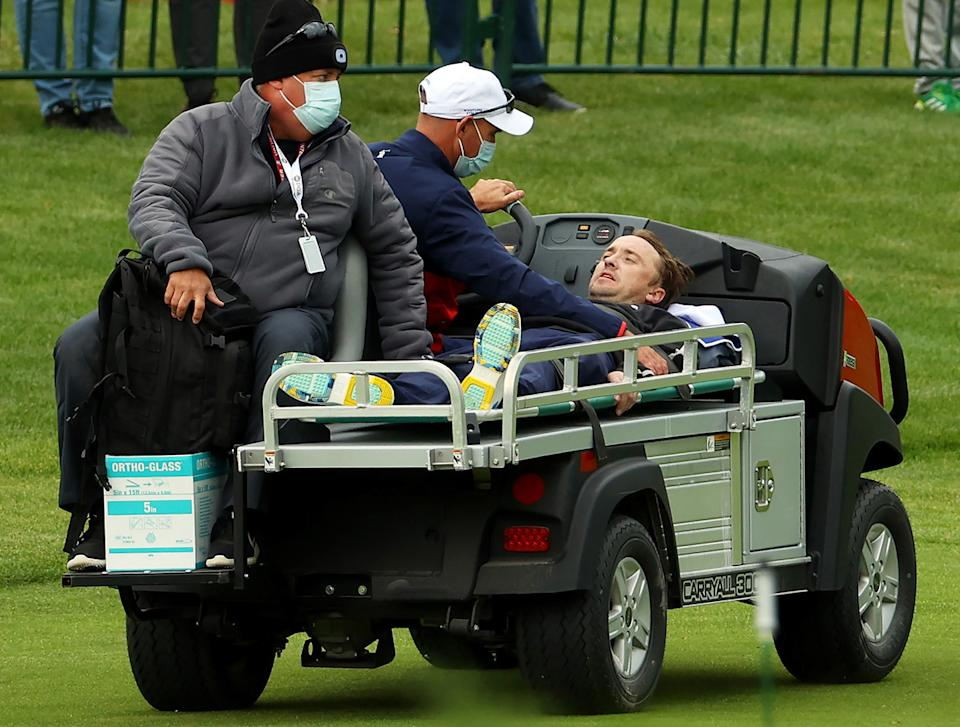 Tom Felton in a stretcher after collapsing at a celebrity event before the Ryder Cup