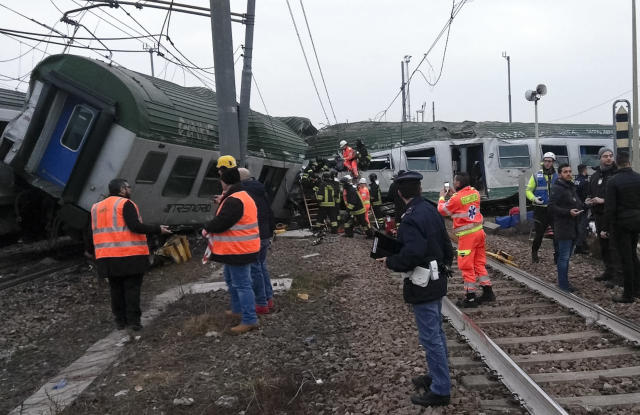 <p>Rescuers work at the wrecked car of a train that derailed at the station of Pioltello Limito, on the outskirts of Milan, Italy, Thursday, Jan. 25, 2018. (Photo: AP) </p>