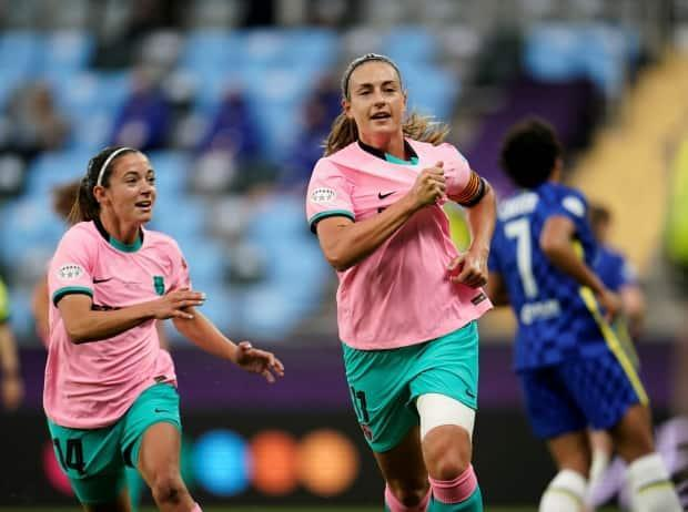 Alexia Putellas, right, celebrates a goal with teammate Aitana Bonmatí during Barcelona's 4-0 win over Chelsea in the final of the UEFA Women's Champions League on Sunday.   (Bjorn Larsson Rosvall/Reuters - image credit)