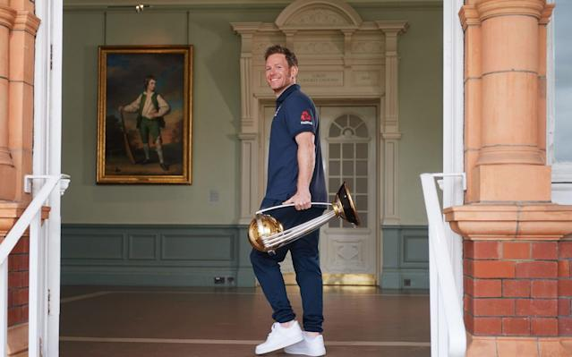 Captain Eoin Morgan and the trophy - PA