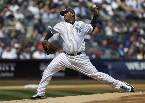 New York Yankees starting pitcher CC Sabathia delivers in the first inning at an Opening Day baseball game at Yankee Stadium in New York, Monday, April 1, 2013. (AP Photo/Kathy Willens)