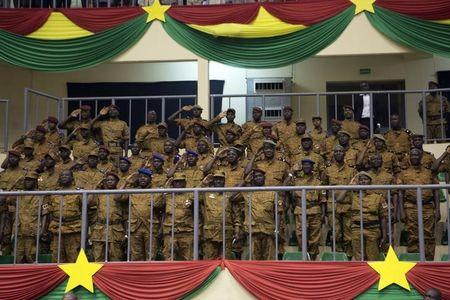 Soldiers salute during the swearing-in ceremony of Burkina Faso's President Michel Kafondo in Ouagadougou