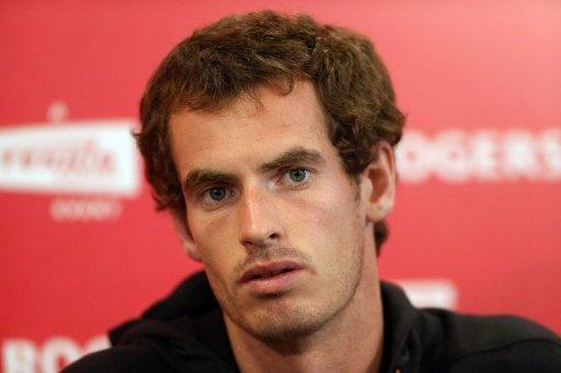 Andy Murray of Scotland talks to the media after withdrawing due to injury from the Rogers Cup Presented By National Bank at Rexall Centre at York University in Toronto, Ontario, Canada