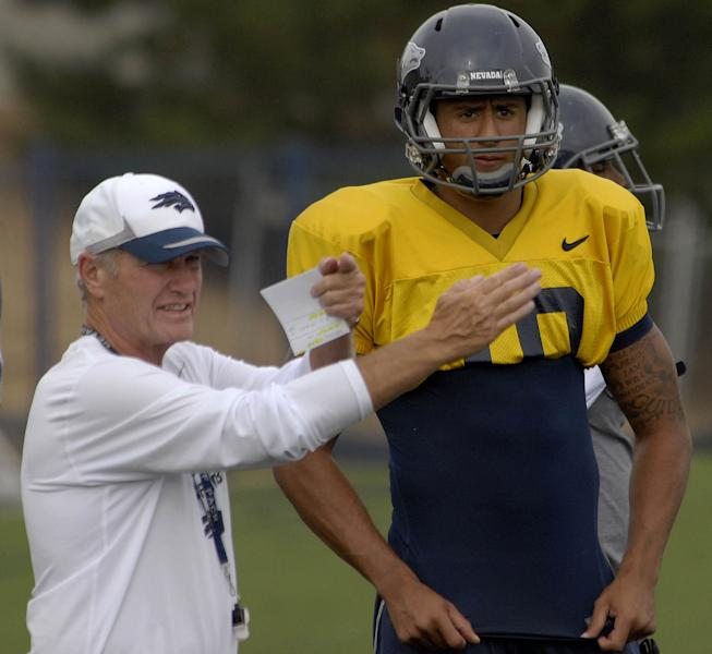 ADVANCE FOR WEEKEND EDITIONS, FEB. 2-3 - In this photo taken Sept. 13, 2010, Nevada quarterback Colin Kaepernick watches as coach Chris Ault gives instruction during football practice in Reno, Nev. The plays that could win the Super Bowl for the San Francisco 49ers came from as unlikely place as the quarterback running them. Chris Ault developed them at Nevada, where a kid who never ran in high school proved the perfect fit for the most innovative offense football has welcomed in decades. (AP Photo/Reno Gazette-Journal, Tim Dunn) NO SALES, NEVADA APPEAL OUT, SOUTH RENO WEEKLY OUT