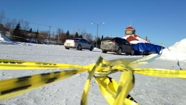 The area around the Via Rail station in Bathurst remained cordoned off in January 2015 as Nova Scotia RCMP investigate the fatal shooting of Michel Vienneau by Bathurst city police. (Bridget Yard/CBC - image credit)