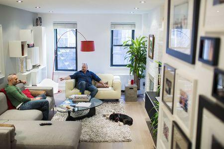 LGBT activist Daniel Maury relaxes at home with his partner, Mark Paulson, in New York April 13, 2015. REUTERS/Lucas Jackson