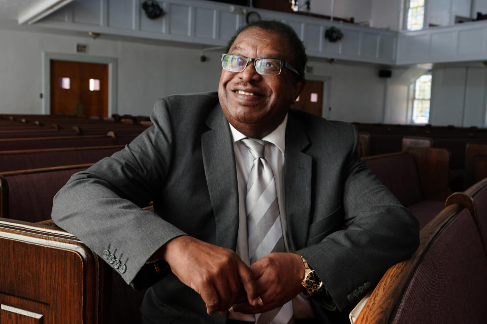 """Rev. Timothy McDonald III poses for a portrait at First Iconium Baptist Church, Monday, Feb. 22, 2021, in Atlanta. After record turnout led to stunning GOP losses in the once reliably red state, Republican lawmakers are forging ahead with an aggressive slate of voting legislation that critics argue is tailored toward curtailing the power of Black voters. """"It's a new form of voter suppression, the Klan in three-piece suits rather than white hoods,"""" said McDonald, whose church has participated in """"souls to the polls"""" events. """"They know the power of the Black vote, and their goal is to suppress that power."""" (AP Photo/John Bazemore)"""
