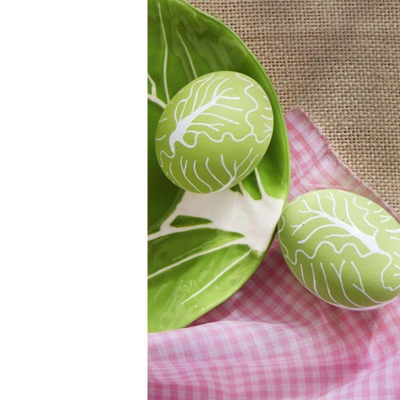 "<p>Pay homage to your favorite veggie with Country Living's adorable romaine inspired egg design.</p><p><em>Get the tutorial at <a href=""https://www.countryliving.com/diy-crafts/how-to/g1282/easter-egg-decorating-ideas/?slide=30"" rel=""nofollow noopener"" target=""_blank"" data-ylk=""slk:Country Living"" class=""link rapid-noclick-resp"">Country Living</a>.</em></p>"