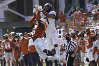 West Virginia's Isaiah Esdale (9) catches a pass over Texas' D'Shawn Jamison (5) during the first half of an NCAA college football game in Austin, Texas, Saturday, Nov. 7, 2020. (AP Photo/Chuck Burton)