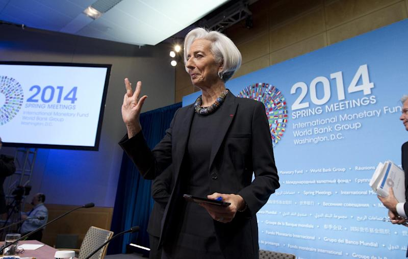 International Monetary Fund (IMF) Managing Director Christine Lagarde waves to the media after a news conference during the IMF/World Bank Spring Meetings at IMF headquarters in Washington, Thursday, April 10, 2014. ( AP Photo/Jose Luis Magana)