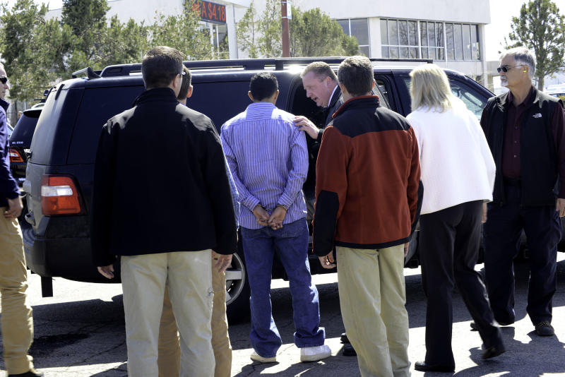 "In this photo provided by the FBI Denver Special Agents transfer custody of Rivera Gracias, one of the FBI's ""Ten Most Wanted Fugitives,"" to Jefferson County Sheriff Office detectives, Wednesday, March 27, 2013 in Denver. Gracias was wanted in Jefferson County in the slaying of 69-year-old Richard Limon, whose beaten and stabbed body was found dumped along a roadside in 2011. (AP Photo/FBI)"