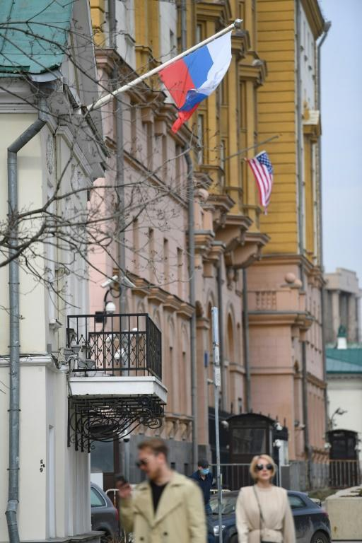 A Russian flag flies next to the US Embassy building in Moscow