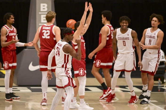 Washington State guard Noah Williams (24) reacts after scoring a basket while being fouled by Stanford guard Michael O'Connell (5) during the first half of an NCAA college basketball game, Saturday, Feb. 20, 2021, in Pullman, Wash. (AP Photo/Pete Caster)