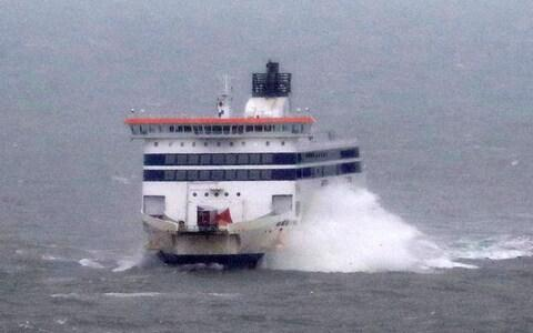 A ferry is buffeted by waves as it arrives during stormy weather at the Port of Dover on Tuesday - Credit: Gareth Fuller/PA