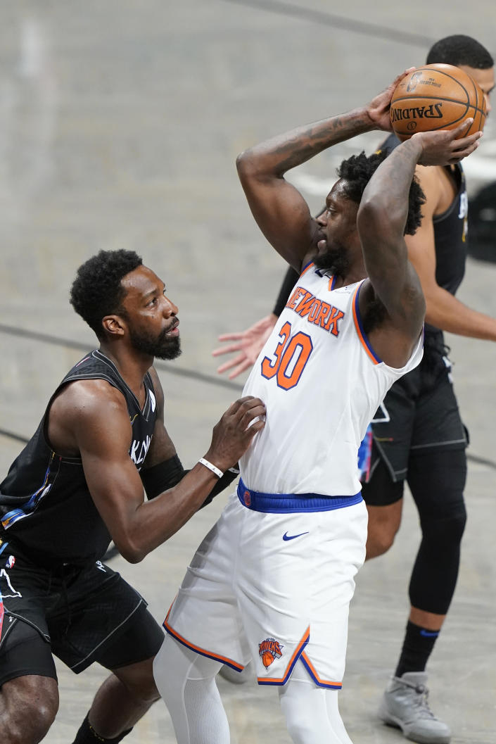 Brooklyn Nets' Jeff Green, left, defends New York Knicks' Julius Randle (30) during the second half of an NBA basketball game Monday, April 5, 2021, in New York. (AP Photo/Frank Franklin II)
