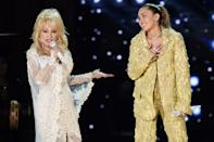 <p>Parton coordinated with her goddaughter Miley Cyrus at the Grammys in 2019 in crystal-encrusted ensembles. </p>