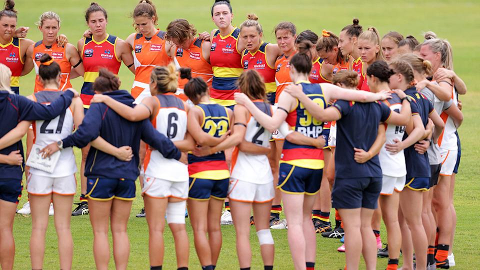 Players from GWS and Adelaide, pictured here remembering Jacinda Barclay before a game in January.
