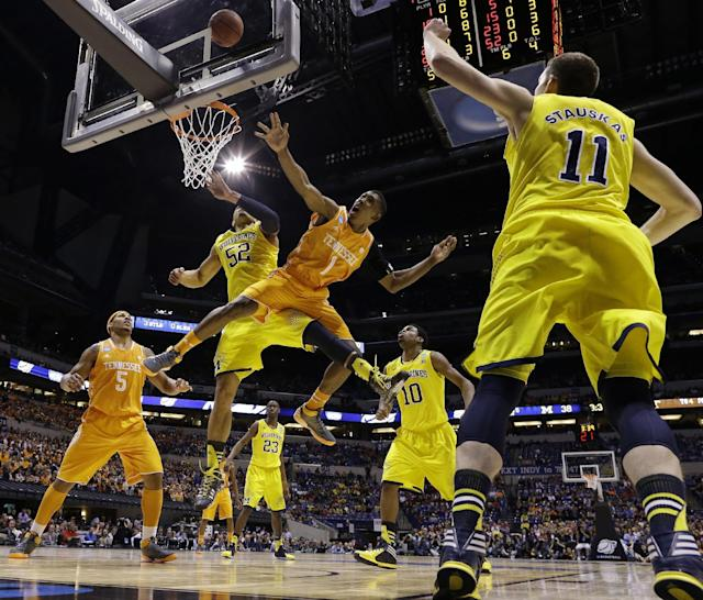 Tennessee's Josh Richardson (1) Michigan's Jordan Morgan (52) go after a loose ball during the first half of an NCAA Midwest Regional semifinal college basketball tournament game Friday, March 28, 2014, in Indianapolis. (AP Photo/Michael Conroy)
