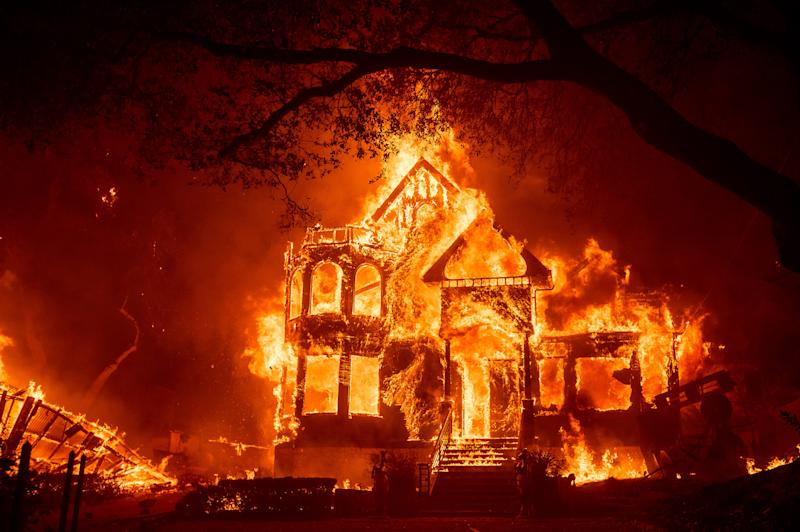 Flames from the Glass Fire engulf the Glass Mountain Inn Sept. 27 in St. Helena, Calif.