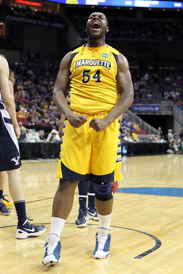 LOUISVILLE, KY - MARCH 15: Davante Gardner #54 of the Marquette Golden Eagles reacts against the Brigham Young Cougars during the second round of the 2012 NCAA Men's Basketball Tournament at KFC YUM! Center on March 15, 2012 in Louisville, Kentucky. (Photo by Andy Lyons/Getty Images)