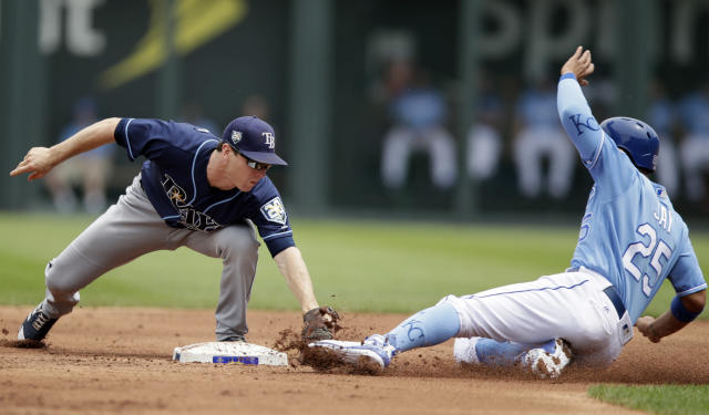 Tampa Bay Rays second baseman Joey Wendle, left, tags out Kansas City Royals' Jon Jay during the first inning of a baseball game at Kauffman Stadium in Kansas City, Mo., Wednesday, May 16, 2018. (AP Photo/Orlin Wagner)