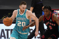 Charlotte Hornets forward Gordon Hayward (20) drives around Toronto Raptors forward Stanley Johnson (5) during the first half of an NBA basketball game Saturday, Jan. 16, 2021, in Tampa, Fla. (AP Photo/Chris O'Meara)