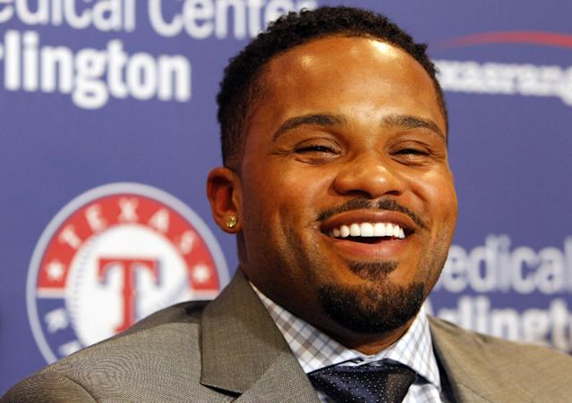 Prince Fielder laughs during a press conference where he was announced as the newsest Texas Rangers baseball player at the Rangers Ballpark in Arlington, Texas, Monday, Nov. 25, 2013. (AP Photo/Richard Rodriguez)