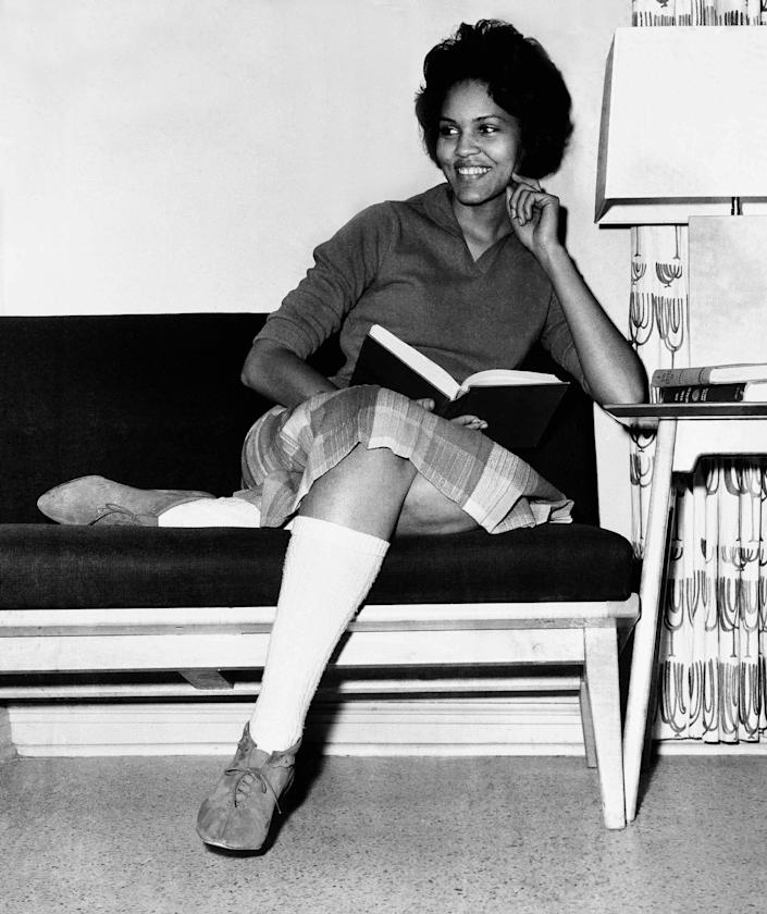 Student Charlayne Hunter, 18, the first Black woman to enter the University of Georgia, relaxes momentarily from her studies in her dormitory in Athens, Ga., on Jan. 11, 1961.