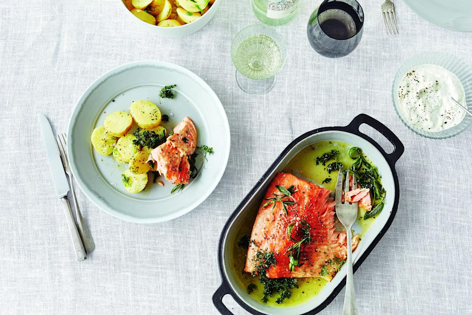 """Bring the bitter herbs into the seder meal by pairing tender, slow-cooked salmon with a peppery horseradish sauce. <a href=""""https://www.epicurious.com/recipes/food/views/salmon-with-potato-salad-and-horseradish-yogurt?mbid=synd_yahoo_rss"""" rel=""""nofollow noopener"""" target=""""_blank"""" data-ylk=""""slk:See recipe."""" class=""""link rapid-noclick-resp"""">See recipe.</a>"""