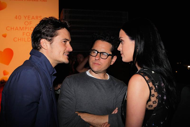 SANTA MONICA, CA - APRIL 10: (l-R) Actor Orlando Bloom, host J.J. Abrams, and singer Katy Perry attend Coach's 3rd Annual Evening of Cocktails and Shopping to Benefit the Children's Defense Fund hosted by Katie McGrath, J.J. Abrams and Bryan Burk at Bad Robot on April 10, 2013 in Santa Monica, California. (Photo by Donato Sardella/Getty Images for Coach)