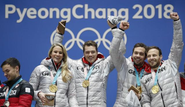 Medals Ceremony - Luge - Pyeongchang 2018 Winter Olympic Games - Team Relay - Medals Plaza - Pyeongchang, South Korea - February 16, 2018 - Gold medalists Natalie Geisenberger, Johannes Ludwig, Tobias Wendl and Tobias Arlt of Germany on the podium. REUTERS/Kim Hong-Ji