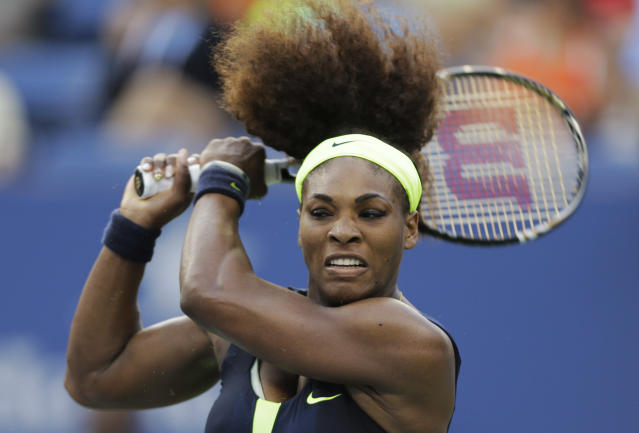 Serena Williams returns a shot to Victoria Azarenka, of Belarus, during the championship match at the 2012 US Open tennis tournament, Sunday, Sept. 9, 2012, in New York. (AP Photo/Mike Groll)