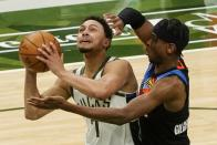 Milwaukee Bucks' Bryn Forbes tries to shoot on Oklahoma City Thunder's Shai Gilgeous-Alexander during the second half of an NBA basketball game Friday, Feb. 19, 2021, in Milwaukee. (AP Photo/Morry Gash)