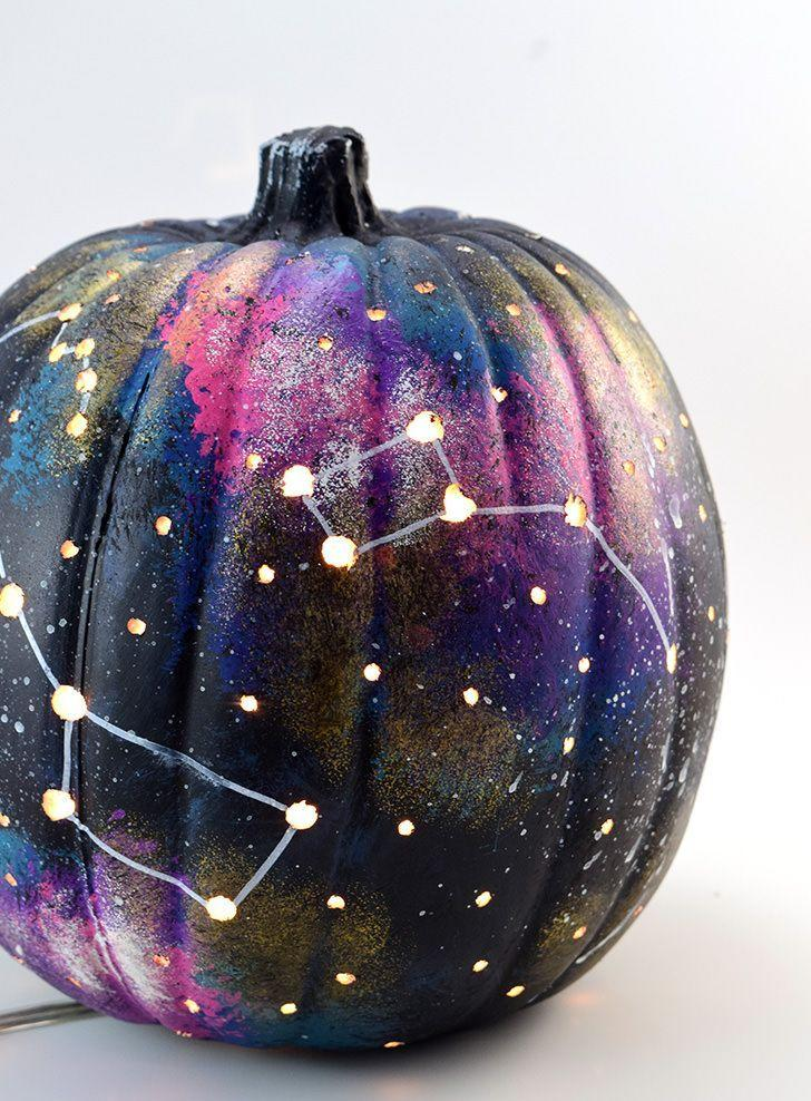 """<p>Splattering white paint on a pumpkin is fun, but copying true-to-life constellations really sets this project apart. The stars will even light up at night if you drill holes throughout and stick string lights inside. </p><p><em><a href=""""http://www.dreamalittlebigger.com/post/galaxy-pumpkin-world-jack-o-lantern.html"""" rel=""""nofollow noopener"""" target=""""_blank"""" data-ylk=""""slk:Get the tutorial at Dream a Little Bigger »"""" class=""""link rapid-noclick-resp"""">Get the tutorial at Dream a Little Bigger »</a></em><br></p>"""