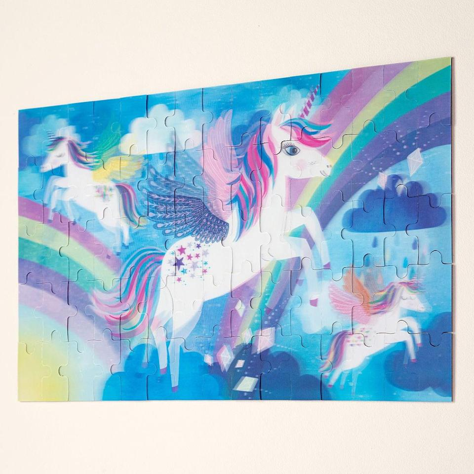 <p>The <span>Magical Moving Unicorn Puzzle</span> ($15) is perfect for the one who loves to solve puzzles. The 75-piece puzzle is bright, colorful, and has transitional pieces that change as they move around. They'll be able to see the unicorns flapping their wings and more.</p>