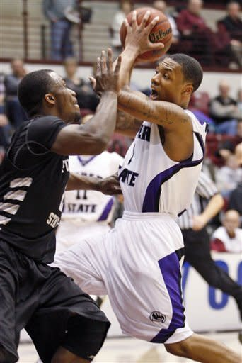 Weber State guard Damian Lillard (1) looks to make a pass under the basket in front of Portland State guard Charles Odum (2) during the second half of an NCAA college Big Sky Tournament basketball game in Missoula, Mont., on Tuesday, March 6, 2012.(AP Photo/ Michael Albans)