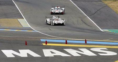 Nick Tandy of Britain drives his Porsche 919 Hybrid number 19 ahead the Audi R18 e-tron quattro number 7 driven by Marcel Fassler of Switzerland, during the Le Mans 24 Hours sportscar race in Le Mans, central France June 14, 2015. REUTERS/Regis Duvignau