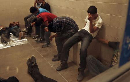 Immigrants who have been caught crossing the border illegally are housed inside the McAllen Border Patrol Station in McAllen