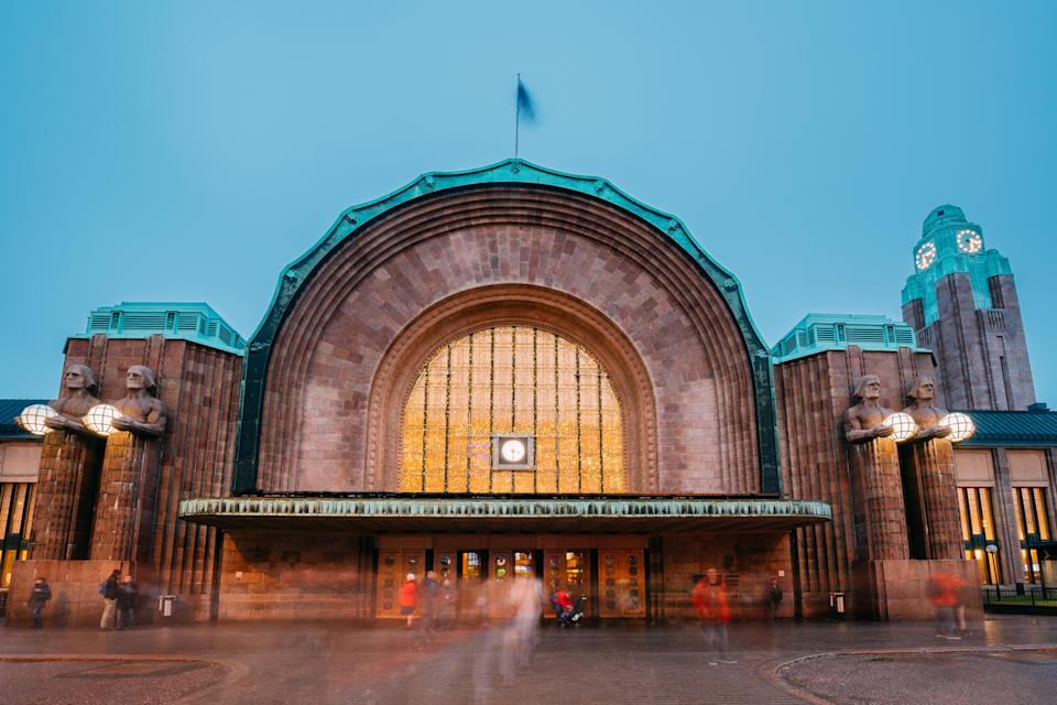 "Built in 1919, the station's iconic architectural feature is four sentry statues that hold spherical lights flanking the terminal's entrance. The granite guards welcome hundreds of thousands of commuters and long-distance passengers heading to St. Petersburg, Russia, and <a href=""https://www.cntraveler.com/story/chasing-winter-in-lapland-finland?mbid=synd_yahoo_rss"" rel=""nofollow noopener"" target=""_blank"" data-ylk=""slk:Finnish Lapland"" class=""link rapid-noclick-resp"">Finnish Lapland</a>, among other destinations, each day. The station was designed by Eliel Saarinen, who would soon immigrate to the U.S. and whose son, Eero, would go on to design the iconic TWA terminal (<a href=""https://www.cntraveler.com/story/the-real-appeal-of-the-twa-hotel-nostalgia?mbid=synd_yahoo_rss"" rel=""nofollow noopener"" target=""_blank"" data-ylk=""slk:now a hotel"" class=""link rapid-noclick-resp"">now a hotel</a>) at New York's JFK airport."
