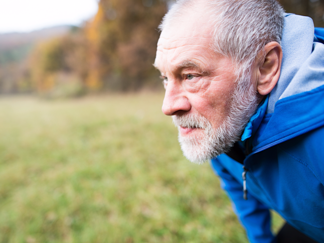 older man elderly man jogging nature running exercise thinking outdoors