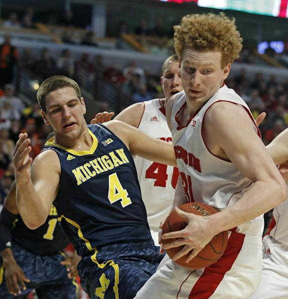 Wisconsin's Mike Bruesewitz and Michigan's Mitch McGary (4) battle for a rebound during the first half of an NCAA college basketball game at the Big Ten tournament Friday, March 15, 2013, in Chicago. (AP Photo/Charles Rex Arbogast)