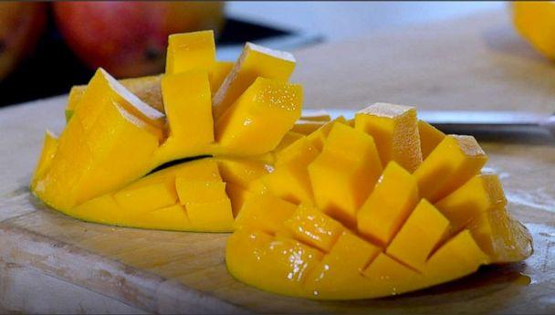 PHOTO: Celebrity chef Cat Cora shows 'GMA' that mangos don't have to be so hard to cut. (ABC News)